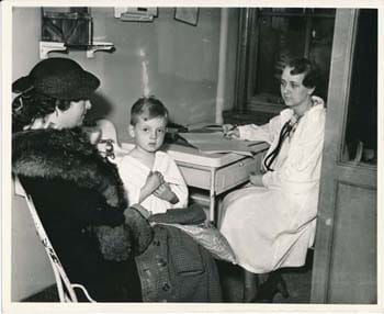 Senior medical student taking patient history, 1930s