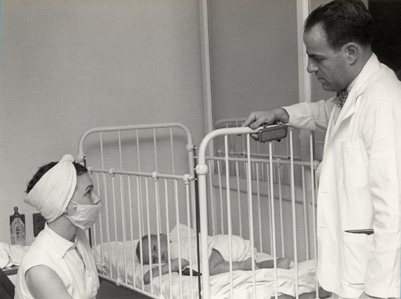 1951 Bass talks to woman