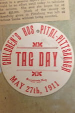 """One of the tags from the first """"Tag Day"""" in 1911, pasted in the same scrapbook."""
