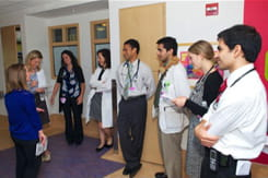 Our team of physicians, nurses and specialists gathers outside of a patient room getting ready to go in for patient- and family-centered rounds.
