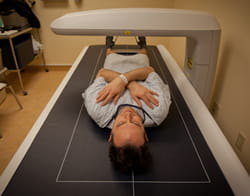 Justin getting a bone mineral density test, also known as a DEXA scan