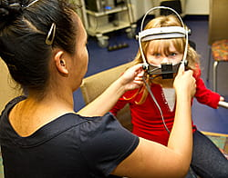 Rhona Galera, MS, CCC-SLP, performs nasometry on a child with abnormal vocal resonance.