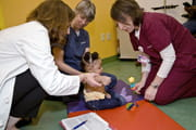 Doctors assist a patient with a brachial plexus injury