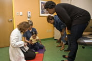 Doctors assist a child with a brachial plexus injury.