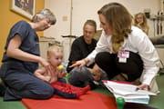 Doctors treat a child with brachial plexus injuries.