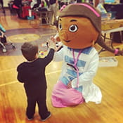 A PALS resident dressed up as Doc McStuffins