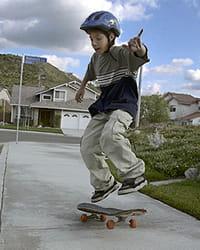 Middle schooler skateboarding
