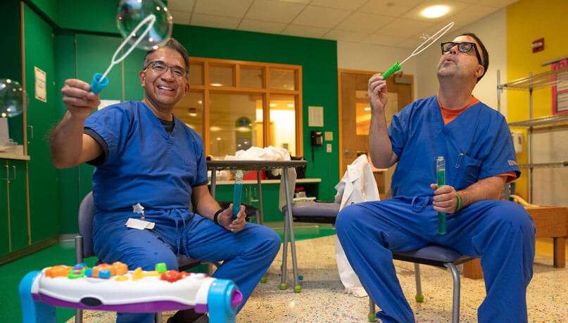 Blowing bubbles and putting smiles on our kids' faces! Transplant surgeons, Dr. Mazariegos and Dr. Soltys, enjoying some time in our playrooms!