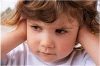 Girl holding her ears