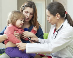 Doctor with mom and girl