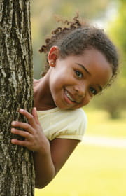 Pediatric Environmental Medicine Center girl by tree